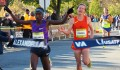 Sam Chelanga (left) edges Tyler Pennel at the finish line of the 2015 .US 12-K National Road Racing Championships in Alexandria, Va.; both men were timed in 34:35 (photo by Jane Monti for Race Results Weekly)