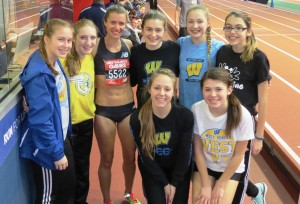 Kim Conley poses with the girls track team of West Seneca West schools (West Seneca, N.Y.) after winning the 2016 New Balance Games invitational mile (photo by David Monti for Race Results Weekly)
