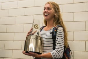 Katie Rainsberger of Air Academy High School (Colorado Springs, CO) poses with her Gatorade National Girls Cross Country Runner of the Year award at her school on Thursday, January 21, 2016. Photo Credit/Gatorade.