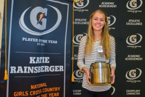 Katie Rainsberger of Air Academy High School (Colorado Springs, CO) poses with her Gatorade National Girls Cross Country Runner of the Year award during an assembly at her school on Thursday, January 21, 2016. Photo Credit/Gatorade.