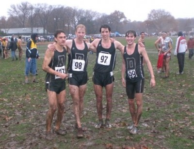Zablocki (far left) and the author (second from left) after a muddy NCAA Northeast Regional in 2009