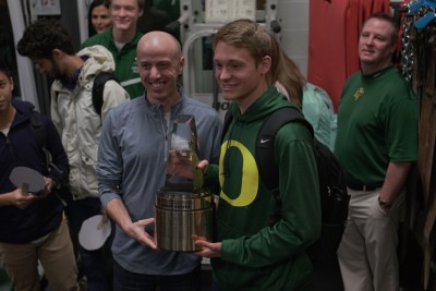 Newly-announced Gatorade National Boys Cross Country Runner of the Year Andrew Hunter poses with 2004 U.S. Olympian and American Mile Record Holder Alan Webb moments after being presented with his trophy at Loudoun Valley High School on Wednesday, February 24, 2016. Photo Credit/Gatorade