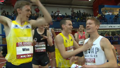 Hunter celebrates moments after the scoreboard confirmed his sub-4:00