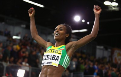 Dibaba celebrating World Indoor gold in 2016 (Photo by Ian Walton/Getty Images for IAAF)""