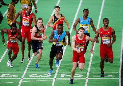 """Christopher Giesting receives the baton from Calvin Smith (Photo by Christian Petersen/Getty Images for IAAF)"""""""