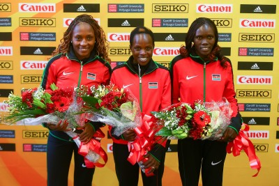 """CARDIFF, WALES - MARCH 26: Gold medalist Peres Jepchirchir of Kenya (C), Silver medalist Cynthia Jerotich Limo of Kenya (R) and Bronze medalist Mary Wacera Ngugi of Kenya (L) after winning the Women's Half Marathon during the IAAF/Cardiff University World Half Marathon Championships on March 26, 2016 in Cardiff, Wales. (Photo by Jordan Mansfield/Getty Images for IAAF)"""