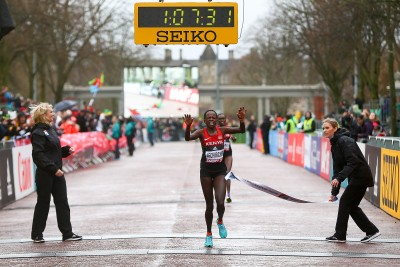 """CARDIFF, WALES - MARCH 26: Peres Jepchirchir of Kenya crosses the line to win the Women's Half Marathon during the IAAF/Cardiff University World Half Marathon Championships on March 26, 2016 in Cardiff, Wales. (Photo by Jordan Mansfield/Getty Images for IAAF)"""