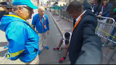 Berhanu is feeling the effort ... maybe regretting the post-race triple jump.