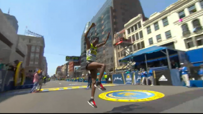 Berhanu celebrates with a hop, skip and jump after the finish line.
