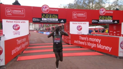 Kipchoge tries to hide his frustration at coming eight seconds short of the WR