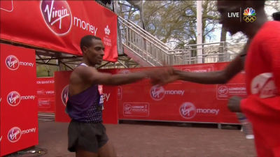 Bekele accepts congratulations from old rival Kipchoge after the race