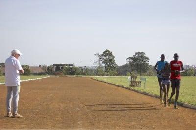 Canova looks on as Kiplagat begins her workout at Moi University