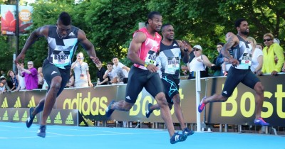 (left to right) Marvin Bracy of the United States, Yohan Blake of Jamaica, Akani Simbine of South Africa and Keston Bledman of Trinidad & Tobago compete in the 100m at the inaugural adidas Boston Boost Games (photo by Chris Lotsbom for Race Results Weekly)