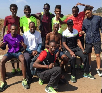 Aden and some of his athletes in Africa