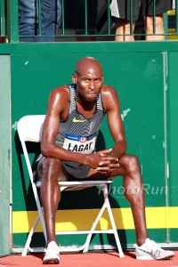 Bernard Lagat Sitting on A Bench after Dropping out while in 3rd