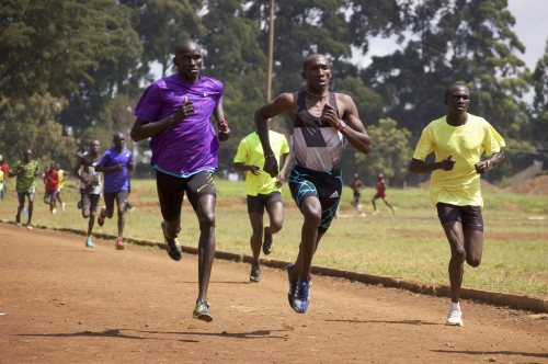 Kwemoi (left) finishing up a rep