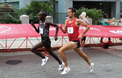 Sam Chelanga (left) battles eventual champion Ryan Hill at the 2016 USA 5-K Championships in Providence, R.I. (photo by Chris Lotsbom for Race Results Weekly)