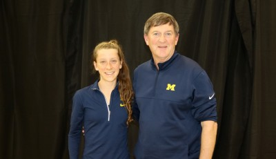 Erin Finn with Michigan coach Mike McGuire in advance of the 2016 NCAA Division I Cross Country Championships in Terre Haute, Ind. (photo by Chris Lotsbom for Race Results Weekly)