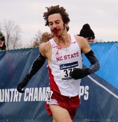 Eli Moskowitz of North Caroline State competing at the 2016 NCAA Division I Cross Country Championships after a bad fall (photo by Chris Lotsbom for Race Results Weekly)