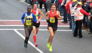 Leonard Korir, Chris Thompson and Ben True setting up for the final sprint of the 2016 Manchester Road Race (photo by David Monti for Race Results Weekly)