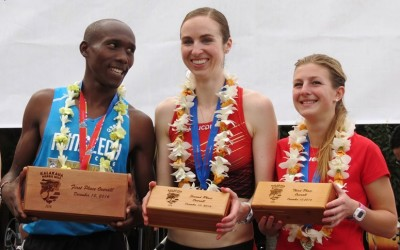 PHOTO: Edwin Kiptoo, Nicole Sifuentes (center) and Shannon Osika after receiving their top-3 awards at the inaugural Kalakaua Merrie Mile in Honolulu on 10 December, 2016 (Photo by Jane Monti for RaceResults Weekly)
