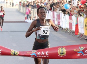 Peres Jepchirchir Grimaces But Gets World Record