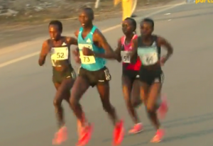 Male Pacer and 3 Women in Lead Pack (Jepchirchir on Left)