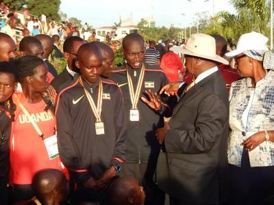Ugandan President Yoweri Museveni Talks to Joshua Cheptegei (center)