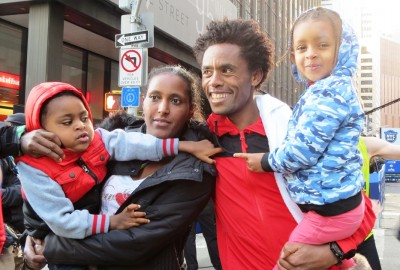 Feyisa Lilesa with his wife Iftu, son Sora and daughter Soko, after winning the 2017 United Airlines NYC Half (photo by Jane Monti for Race Results Weekly)