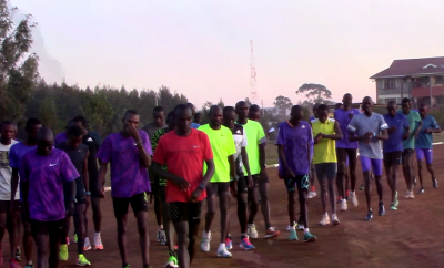 Kipchoge (red) and crew at track
