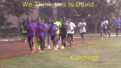 You can make out Kipchoge's white shoes, but his read top is largely obscurred in our photo. David has no shoes and is 20 meters back
