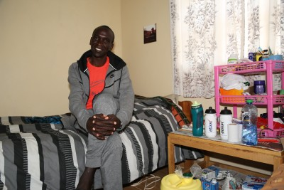 The Olympic champ sleeps on a twin bed and shares an 8x10 room