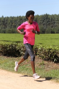 Jemima Sumgong running in the Nandi Hills (by Jean-Pierre Durand for the IAAF)