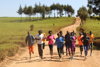Sumgong (center in pink) on her training run with the Nandi tea plantations in the backdrop (photo from IAAF Day in the Life Project)