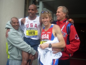 PHOTO: Meb Keflezighi and Ryan Hall with their fathers, Russom and Mickey, after the 2010 Boston Marathon (photo by Chris Lotsbom for Race Results Weekly).