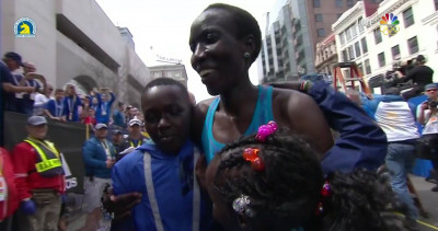 Kiplagat celebrates with some of her children