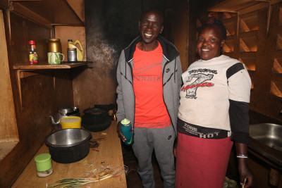 Kipchoge with the Global camp's cook, Mary. Photo courtesy Jean-Pierre Durand for the IAAF.