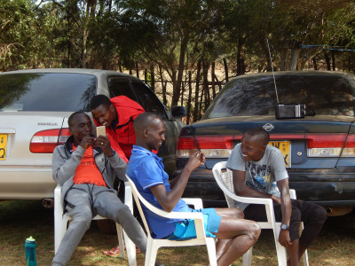 Kipchoge and his training mates relax after a morning workout. Photo by Weldon Johnson.