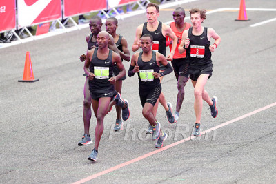 Chris Derrick (tall guy in center) and Andrew Bumbalough (far right) pace Eliud Kipchoge