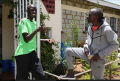 Steeplechaser Brimin Kiprop Kipruto chats with Kipchoge. Photo courtesy Jean-Pierre Durand for the IAAF.