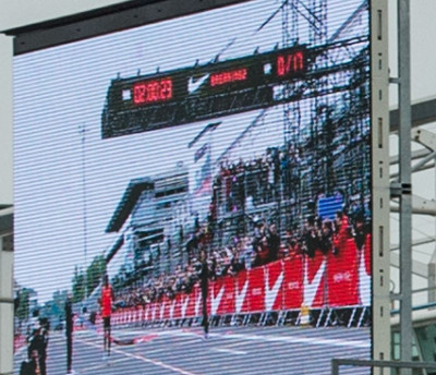 Blown up picture of video board in background showing 2:00:23