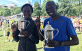 Joan Chelimo and Daniel Chebii celebrate after winning the 2017 B.A.A. 10-K, presented by Brigham and Women's Hospital (photo by Chris Lotsbom for Race Results Weekly)