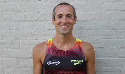 Dathan Ritzenhein shows off his new Hansons Brooks kit (photo by Delachaise Jackson for Brooks; used with permission)