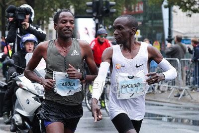 Adola was so new to the marathon Kipchoge had to tell him to follow the blue line
