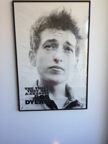 12 years after he first hung it on his office wall, Fox's Bob Dylan poster offers a reminder of the program's humble origins