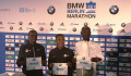 Eliud Kipchoge, Kenenisa Bekele and Wilson Kipsang pose for photographers before the 2017 BMW Berlin Marathon (photo by David Monti for Race Results Weekly)