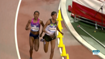 Kipyegon and Hassan side by side on the final turn