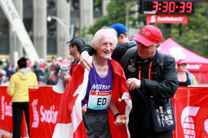 Ed Whitlock with Scotiabank Toronto Marathon race director Alan Brookes after finishing the 2012 race at age 81 (Photo Credit: Victah Sailer/Photo Run, used with permission)