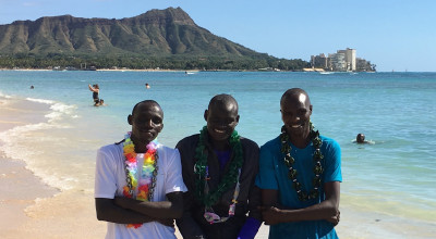 (left to right) Lawrence Cherono, Dennis Kimetto and Wilson Chebet of Kenya in advance of the 2017 Honolulu Marathon on Waikiki Beach (photo by Jane Monti for Race Results Weekly)