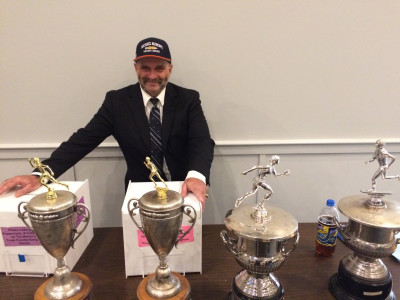Mahon and his trophies (the boys' and girls' Mahon Cups are on the right)